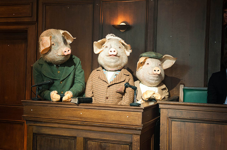 The Three Little Pigs in court, awaiting their fate