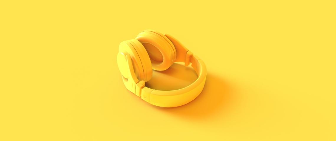 Un casque de musique jaune sur fond jaune