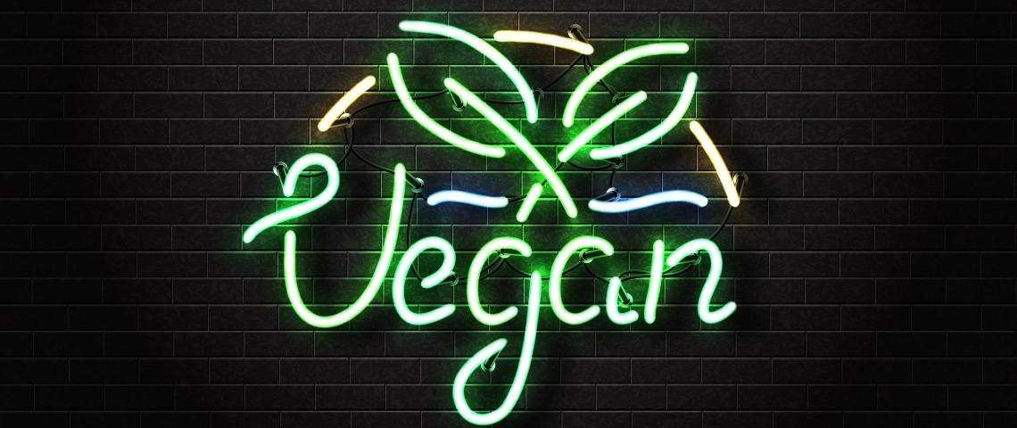 Un néon vert fluo avec le mot  - vegan -