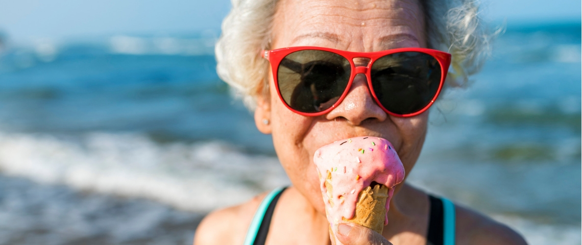 Senior woman eating an ice-cream