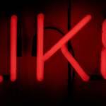 Un like dessiné avec des néons rouges