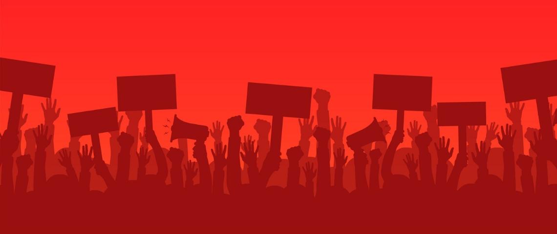 des silhouette de gens en manifestation