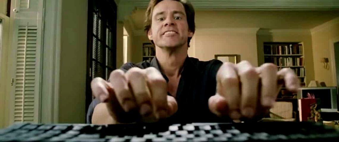 jim carrey tapant sur un clavier