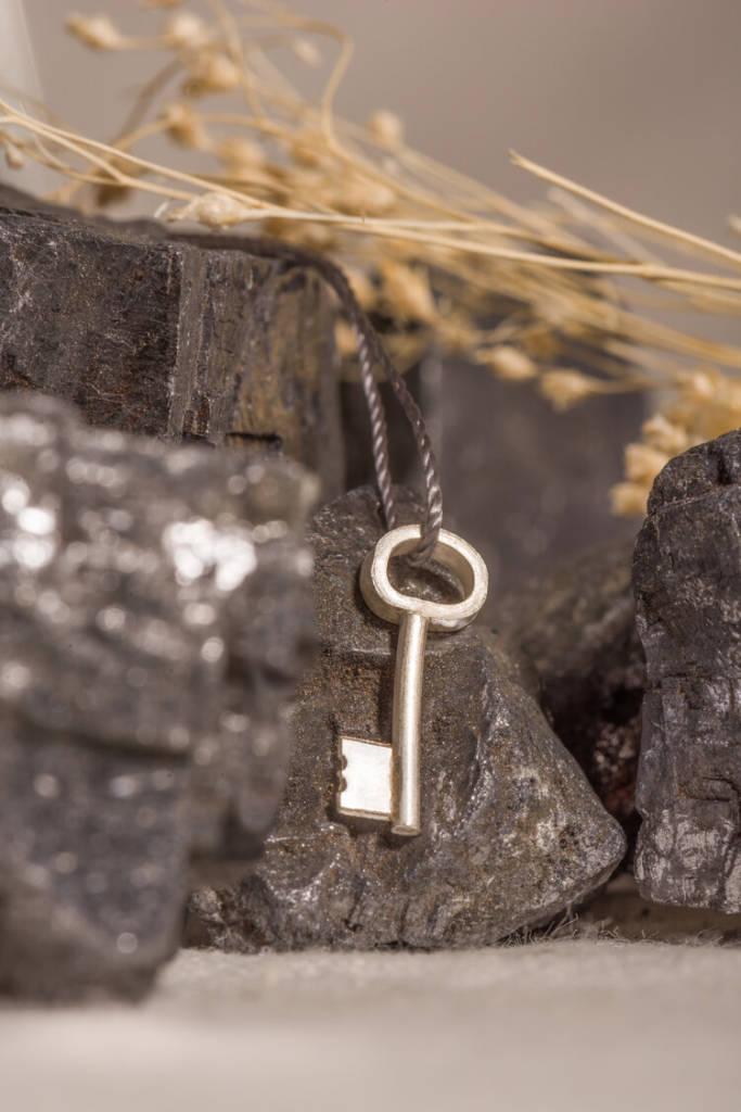 Pendentif en forme de clé
