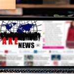 Ordinateur avec à l'écran l'inscription Fake News