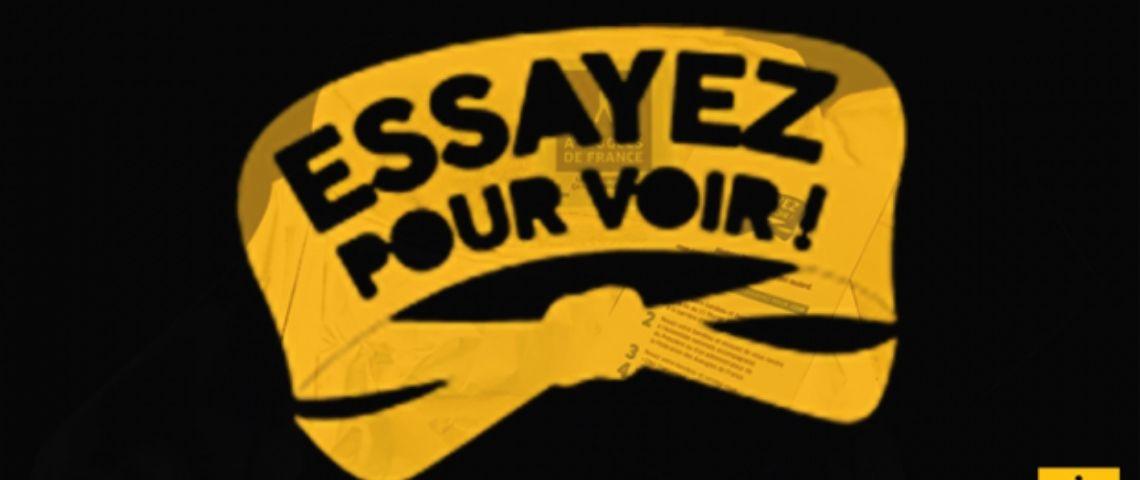 Logo campagne Essayer pour voir avec un bandeau noir