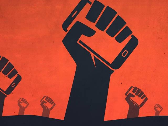 Une affiche de propagande montrant des mains tenants des portables