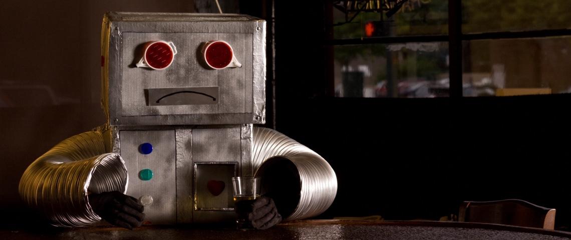 Un robot triste au bar