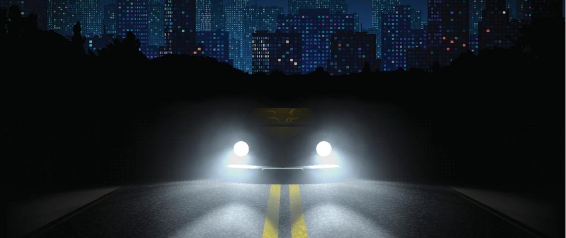 Une voiture avec les phares allumés dans la nuit