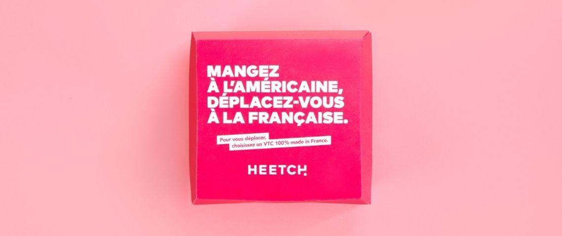 Message sur un emballage Heetch :  - Mangez à l'américaine, déplacez-vous à la francaise. Pour vous déplacer, choississez un VTC made in France